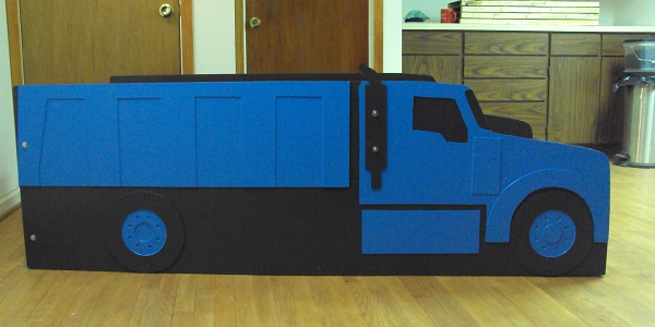 full blue utility truck bed side view