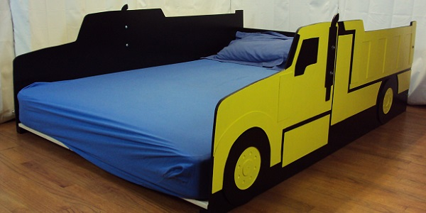 yellow dump truck bed side view