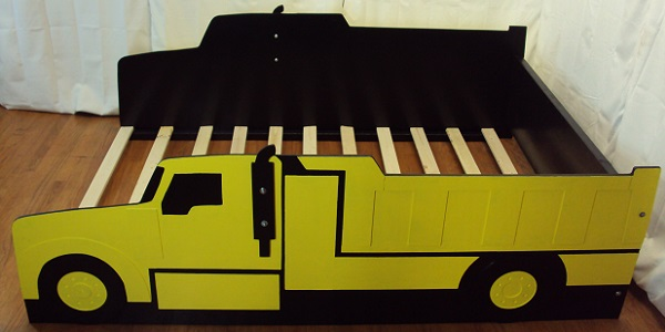 yellow dump truck bed above side