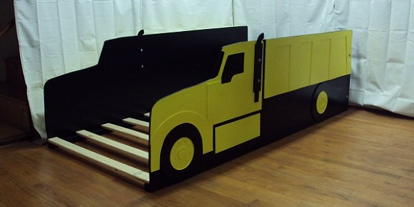 yellow dump truck front three-quarter view